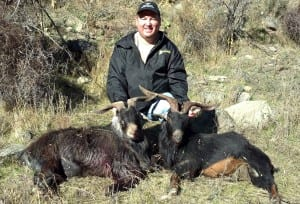 Eric with two running billy goats he took.