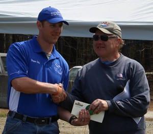 Peter LaBerge awarding match winner Bryan Litz.